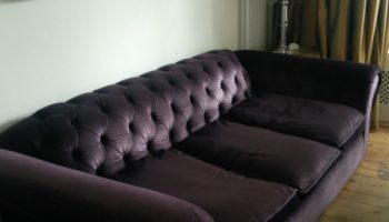 Bradman 4 seater Chesterfield sofa in purple velvet